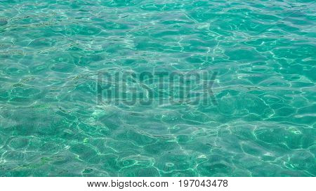 Blue-green transparent and clean sea water background