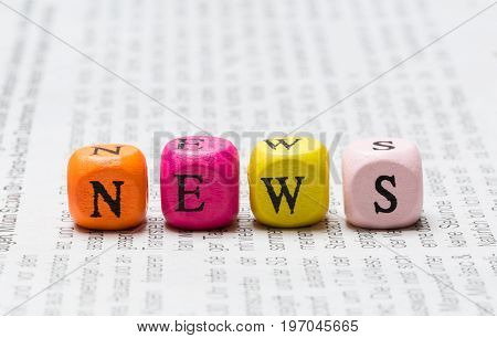 News letter cubes on newspaper macro picure