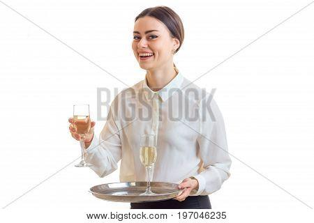 Happy waitress in uniform smiles on camera isolated on white background