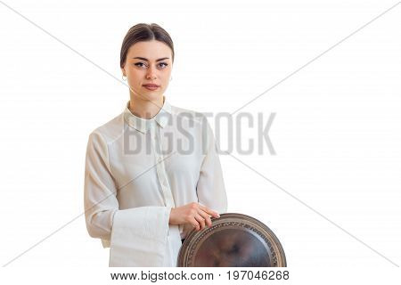 Cute waitress in uniform with trey in hands isolated on white background