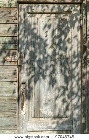 The door of the old wooden barn.