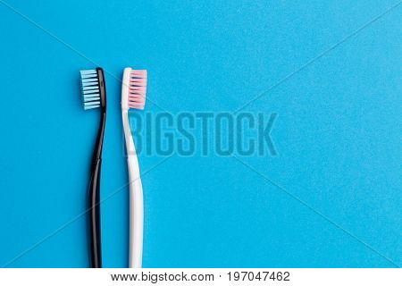 Black , pink toothbrushes, space for text