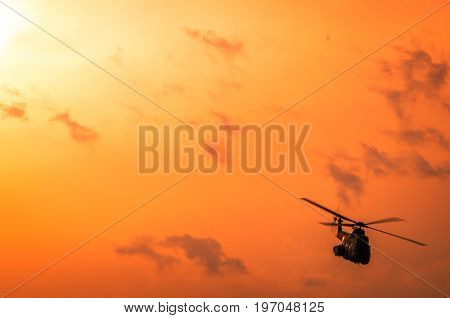 Helicopter on airshow. Aerobatic team performs flight at air show. Flight in twilight.