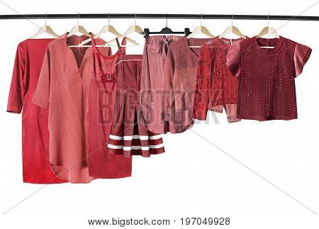 Red woman clothes on clothes racks isolated over white