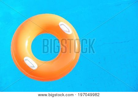 Colorful inflatable swim ring in pool