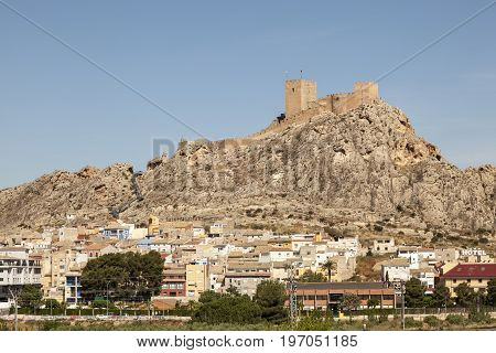 View of town Sax with a historic castle on top of a mountain. Province of Alicante southern Spain