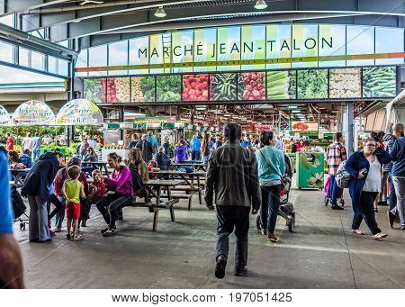 Montreal, Canada - May 27, 2017: Jean Talon Market Sign And Entrance With People In Little Italy Nei