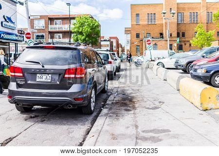 Montreal, Canada - May 27, 2017: Cars Parked Near Jean Talon Market With People In Little Italy Neig