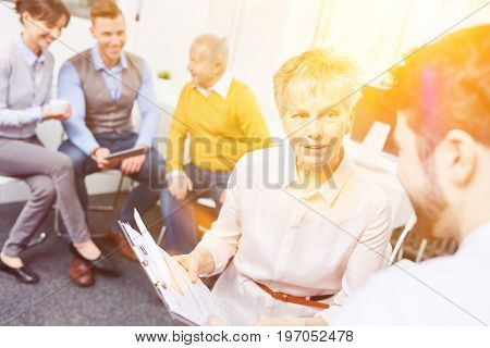 Businesswoman in a business meeting cooperating and working together