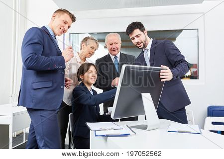 Business team in front of computer for videoconference call