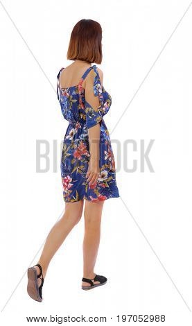 back view of walking woman.   beautiful blonde girl in motion.  backside view of person.  Rear view people collection. Isolated over white background. The girl in a dress in a flower leaves sideways
