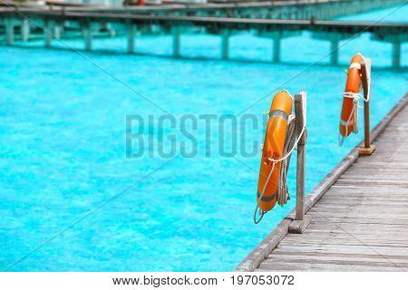 Wooden pontoon with flotation rings at sea resort