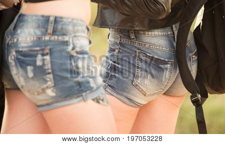 Beautiful short denim shorts on the girl .
