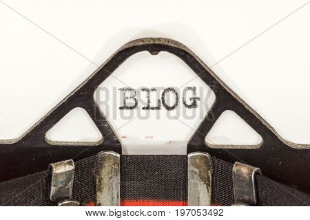 Close up image of a vintage typewriter with paper sheet and the word: BLOG. Copy space for your text