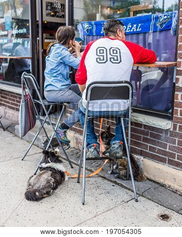 Montreal, Canada - May 27, 2017: Couple Sitting In Restaurant At Table In Outside Seating Area In Pl