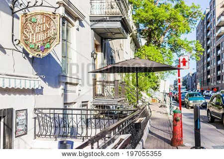 Montreal, Canada - May 27, 2017: Au Vieux Saint Hubert Restaurant Sign On Street In Neighborhood In