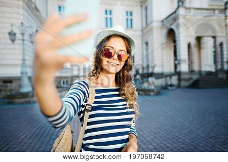 Cheerful Tourist Girl In Old City