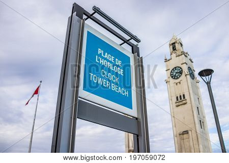 Montreal, Canada - May 27, 2017: Old Port Area With Clock Tower And Sign Stating Plage De L'horloge