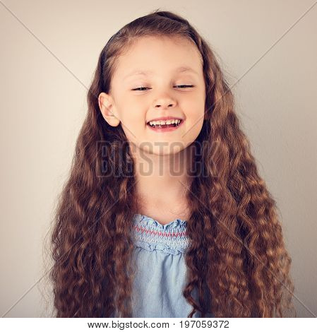 Beautiful Natural Expression Laughing Kid Girl Looking With Long Curly Hair Style. Toned Closeup Por