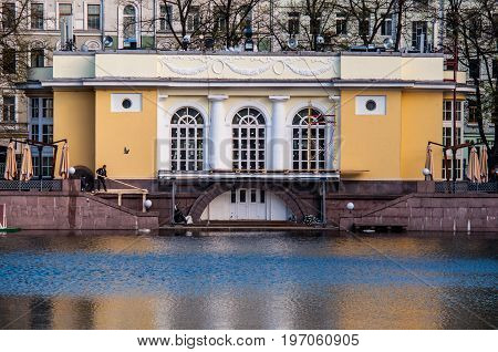 Moscow - May 4 2017: A historical mansion in the park on the embankment of Patriarch's Ponds during reconstruction with people working around