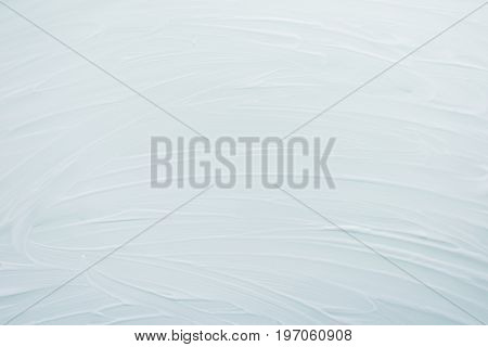 Soaped surface. Abstract simple background, backdrop  the subject of cleaning. White, light shades. Top view. Close-up. Stock photo .