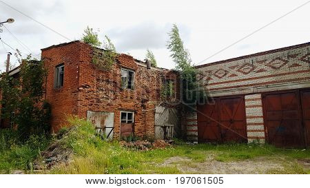 Ruins of brick building. Destroyed house without roof.
