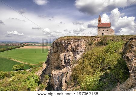 DRAZOVCE SLOVAKIA - APRIL 17: Sitting couples and romatic Drazovsky church on April 17 2017 in Drazovce