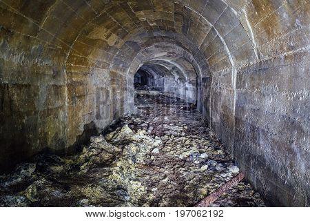 Dirty tunnel of abandoned unfinished soviet bunker in Sevastopol