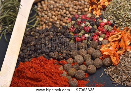Composition with different spices and herbs. Assortment of Thai food Cooking ingredients .Red curry paste ingredients of thai popular food on rustic wooden background. Spices ingredients chili pepper garlicgalangal and Kaffir lime leaves .