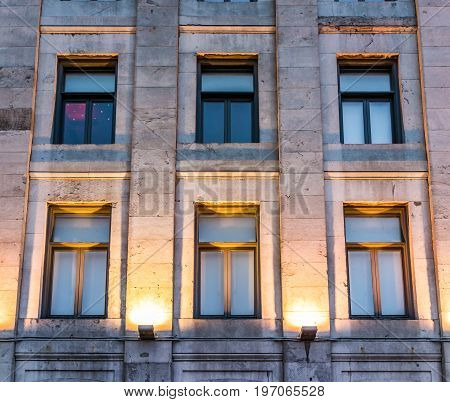 Montreal, Canada - May 27, 2017: Old Town Area Brick Building Illuminated By Yellow Lights And Lante