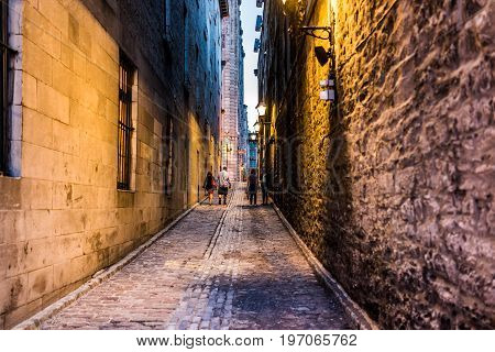 Montreal, Canada - May 27, 2017: Old Town Area With People Walking Up Street In Evening Outside Empt