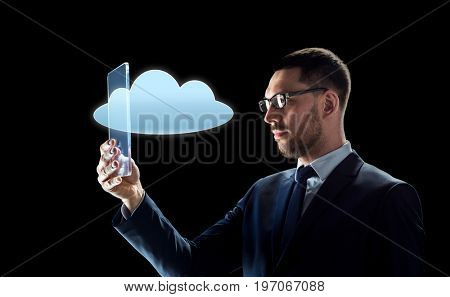 business, augmented reality and modern technology concept - businessman in glasses working with transparent tablet pc computer and cloud computing hologram over black background