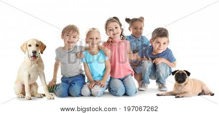 Little children with cute dogs on white background