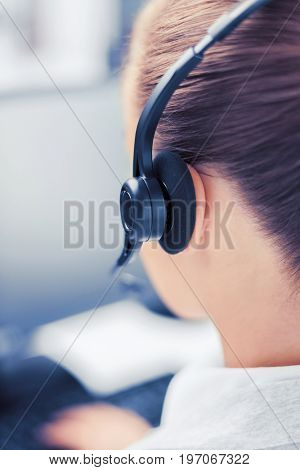 business, office, school and education concept - female helpline operator with headphones