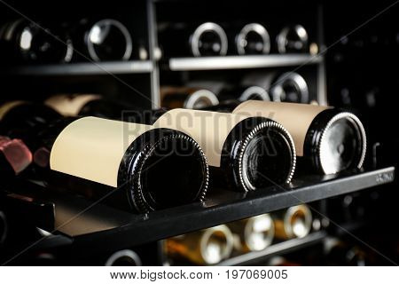 Bottles of wine on shelf at store, closeup