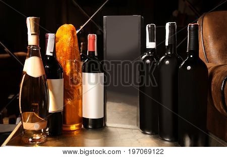 Bottles of wine on tray at store, closeup