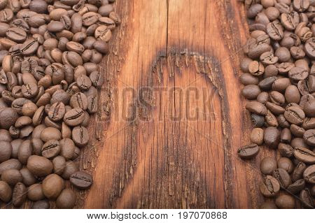 Coffee Bean Background On Wooden Texture