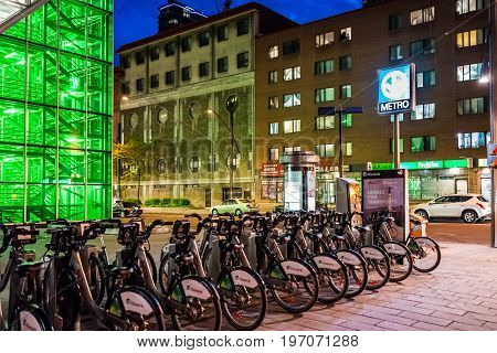 Montreal, Canada - May 26, 2017: Metro Station Sign With Manuvie Bike Parking By Palais Des Congres