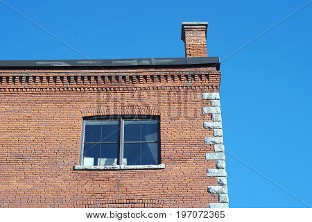 red brick building corner chimney architecture old office business