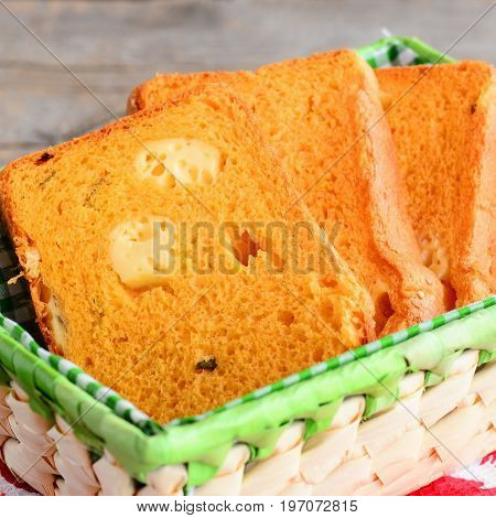 Cheese filled pumpkin bread slices. Pumpkin bread with cheese in a basket. Delicious and unusual bread recipe. Closeup