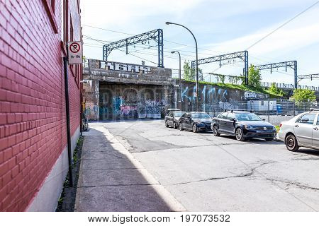 Montreal, Canada - May 28, 2017: Downtown Area With Street Parking Signs, Cars And Graffiti During D