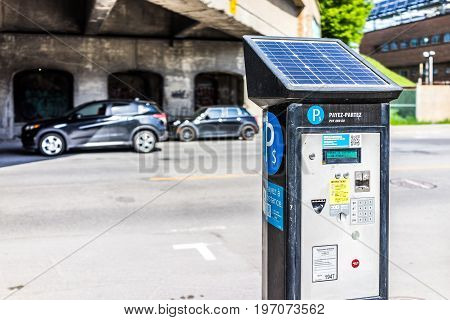 Montreal, Canada - May 28, 2017: Paid Car Street Parking In Downtown City In Quebec Region With Sola