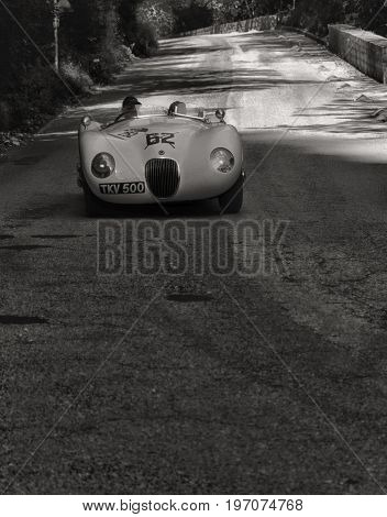 GOLA DEL FURLO, ITALY - MAY 19:JAGUAR C-TYPE 1952 on an old racing car in rally Mille Miglia 2017 the famous italian historical race (1927-1957) on May 19 2017