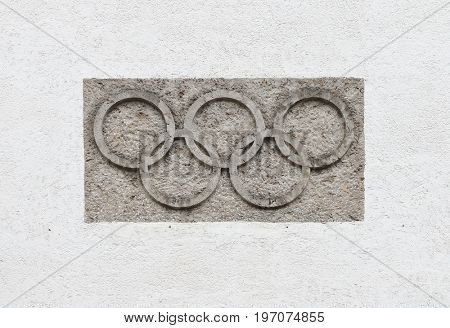 GARMISCH PARTENKIRCHEN GERMANY - JULY 26, 2017: Olympic rings on a wall of The Olympic Ski Stadium. Arena it first gained international fame when the 1936 Olympic Games were held here.