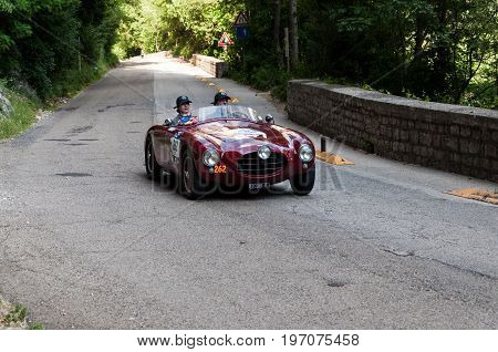 GOLA DEL FURLO, ITALY - MAY 19: ERMINI FIAT 1100/103 1952 1 on an old racing car in rally Mille Miglia 2017 the famous italian historical race (1927-1957) on May 19 2017