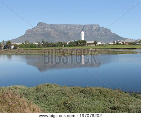 VIEW OF TABLE MOUNTAIN CASTING A SHADOW ACROSS MILNERTON LAGOON, CAPE TOWN, SOUTH AFRICA