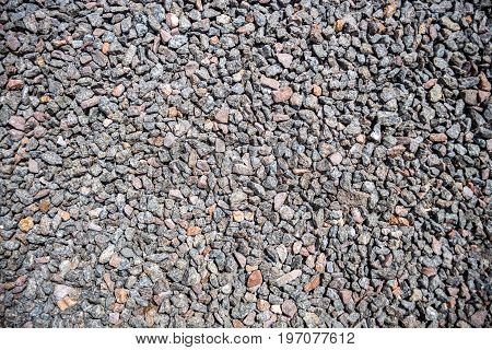 Crushed gravel as background or texture Background of granite gravel