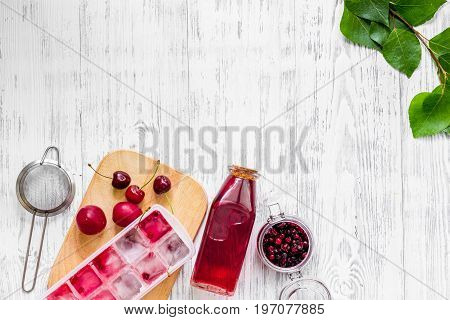 Cranberry morse on wooden table background top view.