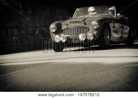 GOLA DEL FURLO, ITALY - MAY 19: AUSTIN HEALEY 100/6 1957 on an old racing car in rally Mille Miglia 2017 the famous italian historical race (1927-1957) on May 19 2017