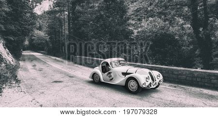 GOLA DEL FURLO, ITALY - MAY 19: BMW 328 COUPÉ 1937 on an old racing car in rally Mille Miglia 2017 the famous italian historical race (1927-1957) on May 19 2017